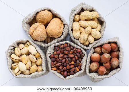 Walnuts, hazelnuts, peanuts, pistachios, and pine (cedar) nuts