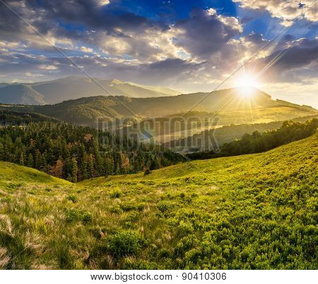 Landscape With Valley And Forest In High Mountains At Sunset