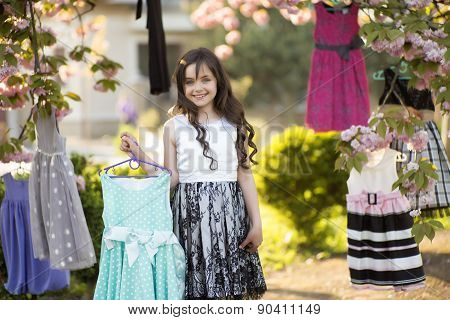 Little Girl Choosing Dresses