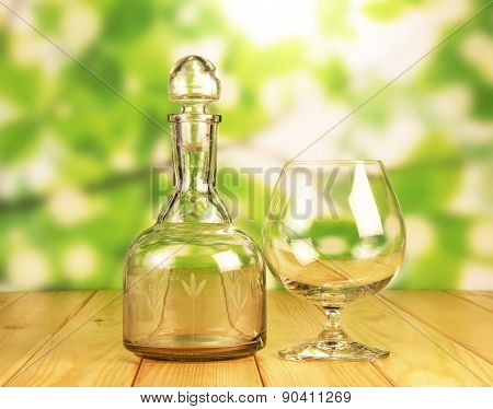 Glass bottle and a glass