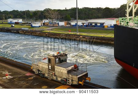 Panama Canal Locomotive Guides Ship