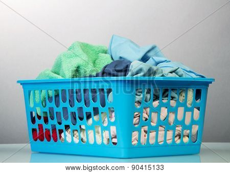 Blue basket with dirty laundry
