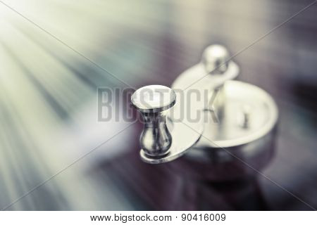 A Metal Coffee-mill Handle On Abstract Background, Monochromatic