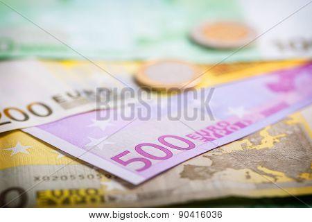 Closeup Of Euro Banknotes And Coins