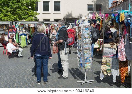 Tourists buy souvenirs at the street market in Vilnius, Lithuania.