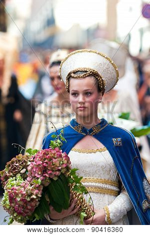 Young Damadel Middle Ages At The Palio With Flowers