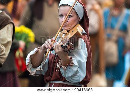 Young Woman Of The Middle Ages Plays A Musical Instrument Similar To The Violin