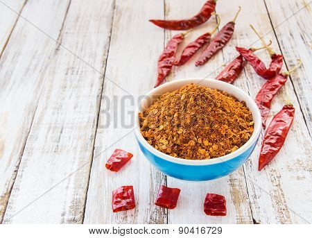 Powder Pepper In A Bowl On The Wooden Background