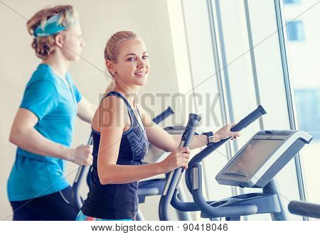 Young People In Modern Gym On The Run Simulator