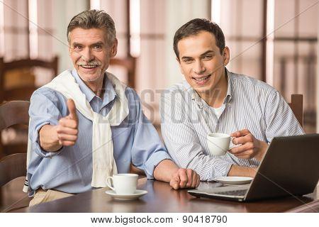 Businessmen In Cafe