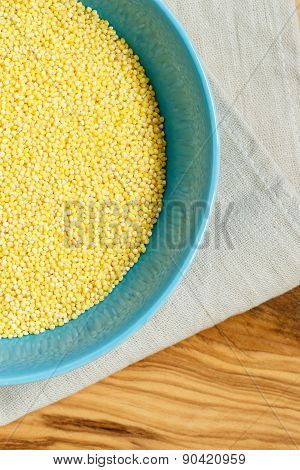 Millet Groats In Blue Bowl On Wooden Table