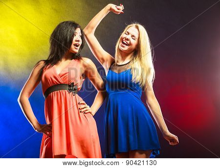 Two Funny Women In Dresses.