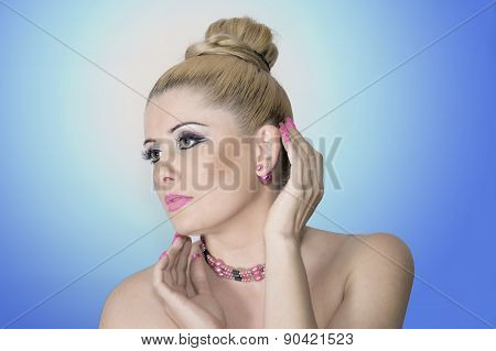 Portrait Of The Beautiful Woman On A Blue Background