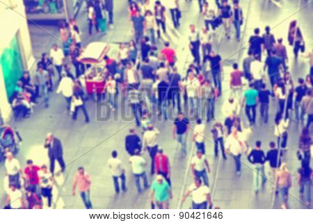 Background With Blurred People Walking On The Street
