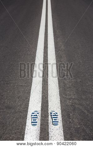 slippers with stipes lying on asphalt
