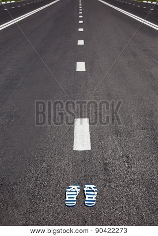 slippers with stipes lying on grey asphalt