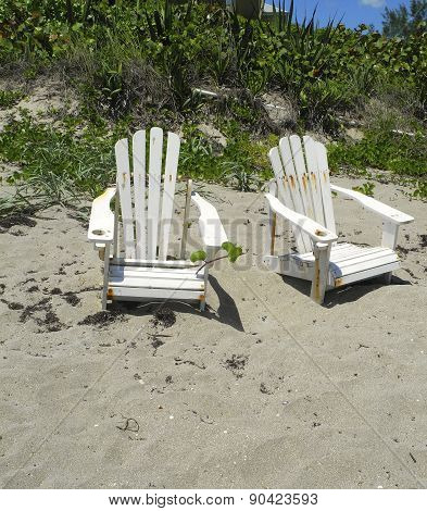 Old Chairs On The Beach