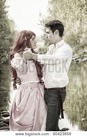 Fairy Tale Couple by a River Looking Dreamy at Each Other