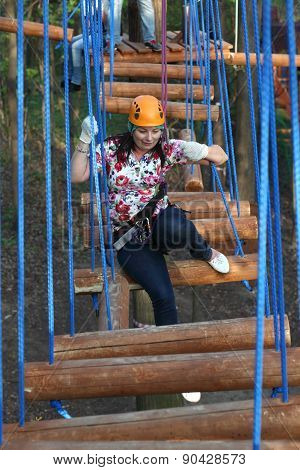 Woman Climber Sitting On A Log