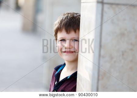 Little Boy Hide And Seek Behind Pillar
