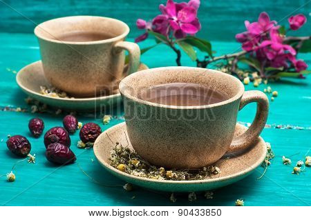 Tea Brewed With Chamomile In Ceramic Mugs