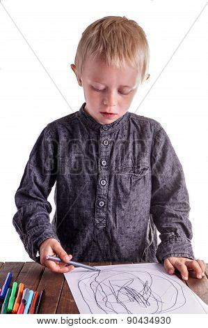 Little Boy Draws A Drawing