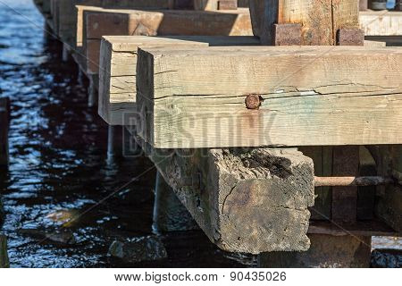 Old Wooden Construction On Water