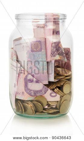Ukrainian hryvnia in glass jar