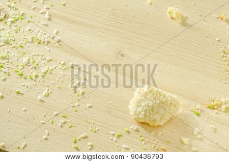 White Wooden Background With Sugar Cookie Crumbs And Coconut Flakes