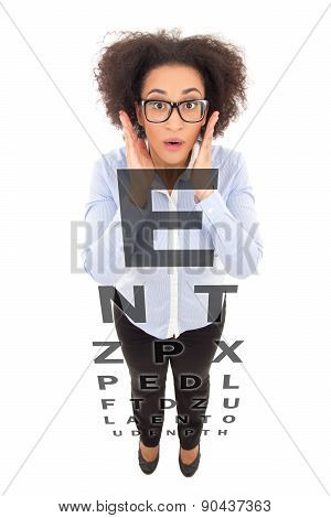 Vision Problem Concept - Beautiful African American Woman In Eyeglasses And Eye Test Chart Isolated
