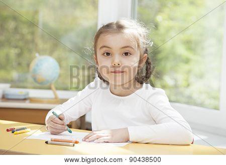 Preschooler Girl Drawing With Pencils