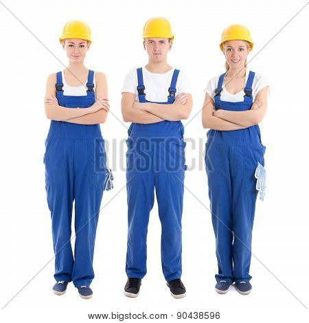 Team Work Concept - Man And Two Women In Builders Uniform Isolated On White