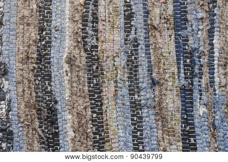 Old cloth carpet texture of. dirty rag, horizontal and vertical stripes, mixed colors