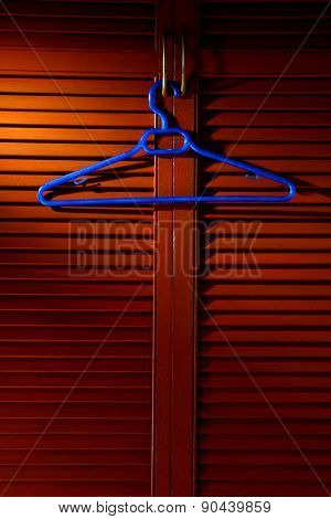 Wooden cabinet door with hanger on its metal handle