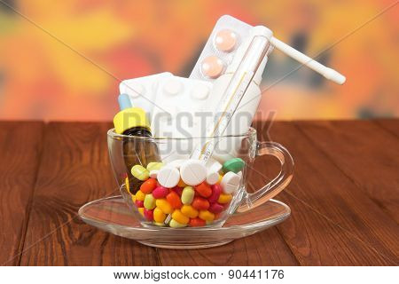 Pills in glass cup