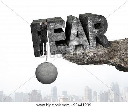 Man Shackled By Ball Hanging Fear Word Edge Cliff Cityscape