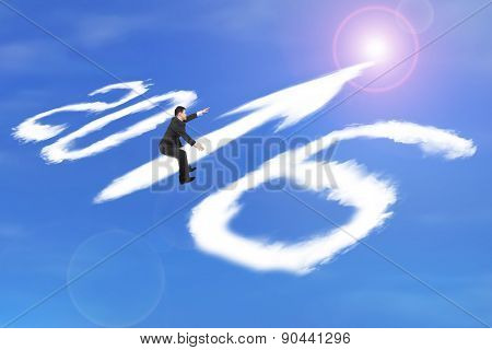 Man Riding 2016 Arrow Up Shape Clouds In Sunlight Sky