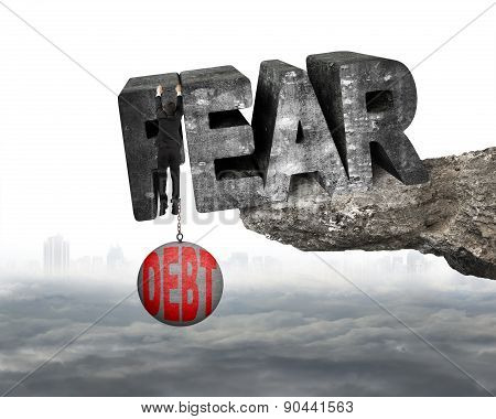 Man Shackled Debt Ball Hanging Fear Word Edge Cliff Cloudscape