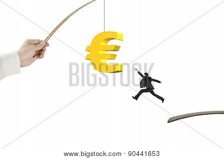 Man Jumping Golden Euro Symbol Fishing Lure Isolated On White
