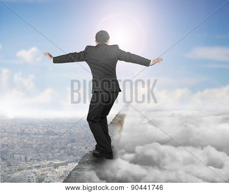 Businessman Balancing On Concrete Ridge With Sky Sunlight Cloudscape Cityscape