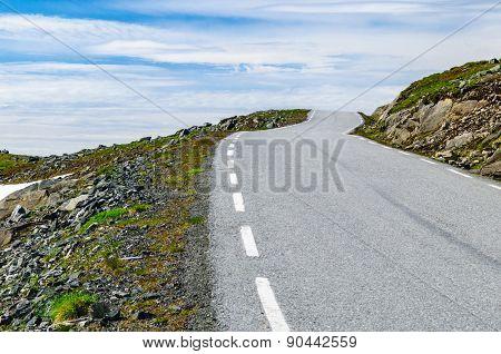Winding Desert Road To Heaven In Norway