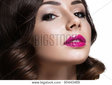 Beautiful woman with evening make-up, pink lips and curls. Beauty face.