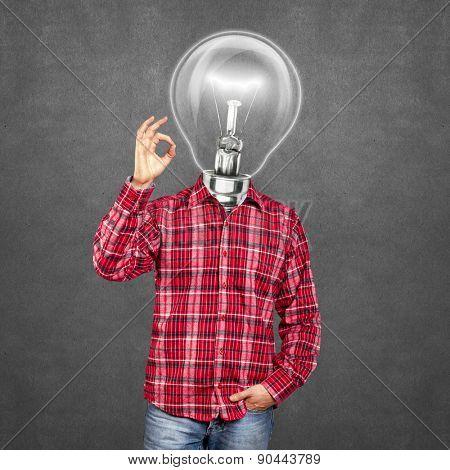 lamp head man, looking on camera, showing OK