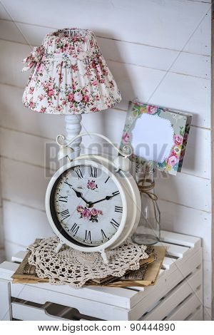 Bedside table with lamp and alarm clock