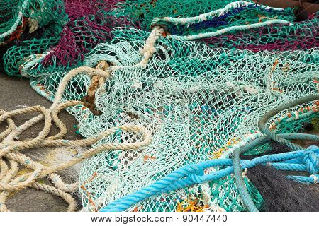 Fishing net on the floor. Fishing nets ready for use.