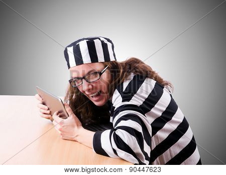 Criminal hacker with laptop on white