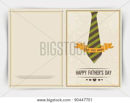 Happy Father\'s Day celebrations greeting card design with neck-tie and golden ribbon.