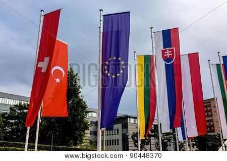 european flag and other flags, symbolism of diplomacy and international cooperation