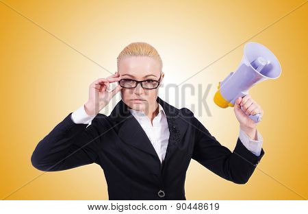 Woman businesswoman with loudspeaker on white