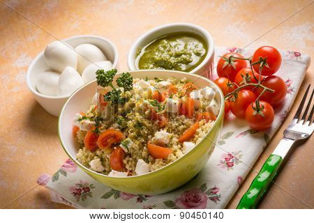 vegetarian couscous with mozzarella tomatoes and pesto sauce